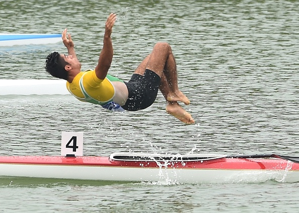 Iran's Saeid Fazloula performed a somersault after coming second along with team mate Ali Aghamirzaeijenaghrad in the men's K2 1000m final ©AFP/Getty Images