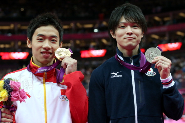 Kai Zou (left) and Kohei Uchimura, pictured at London 2012, will go head to head together again this evening ©Getty Images