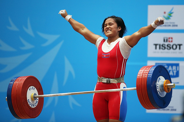 North Korea's Kim Un-ju celebrates winning her country's fourth gold medal in the weightlifting ©AFP/Getty Images
