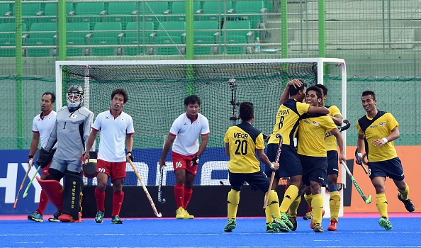 Malaysia celebrate a hockey goal against Japan ©AFP/Getty Images