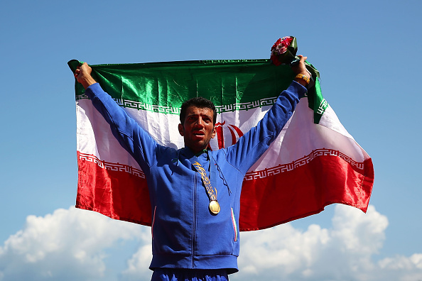 Mohsen Shadinaghadeh of Iran celebrates a nail-biting single sculls rowing victory ©Getty Images