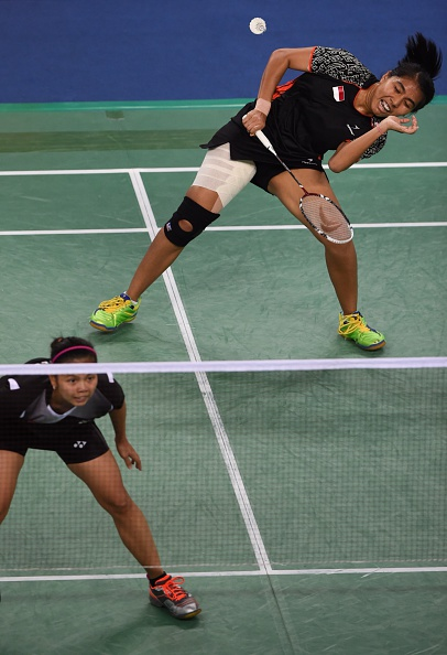 NK Maheswari and G Pollig of Indonesia celebrate the women's doubles badminton gold ©AFP/Getty Images