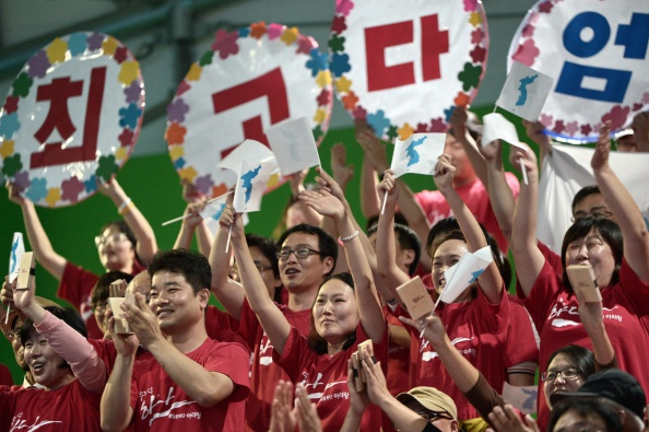 North Korean supporters cheer as the country wins its first gold, and on southern soil ©AFP/Getty Images