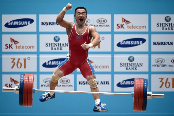 North Korea's Om Yun-Chol sets a world record to claim victory in the under 56kg weightlifting ©AFP/Getty Images
