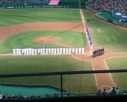 Players line up before the start of the baseball ©Instagram