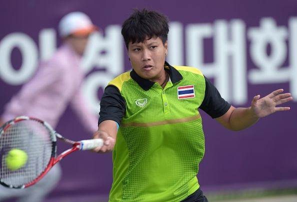 Thailand's Luksika Kumkhum will meet Wang Qiang of China in the final of the women's tennis singles ©AFP/Getty Images