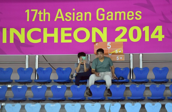 Three rows of, almost, empty seats at the badminton at Incheon 2014 ©AFP/Getty Images