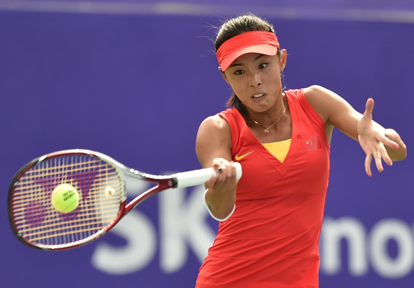 Wang Qiang of China wins the opening set against Kumkhum Luksika of Thailand in their women's singles tennis final ©AFP/Getty Images