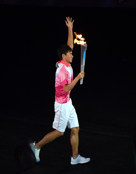 Zhang Jike carrying the Olympic Torch at the Opening Ceremony of Nanjing 2014 last month ©Getty Images
