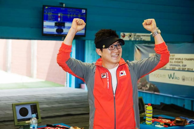 South Korea's Jin Jongoh celebrates after claiming gold in the men's 50 metre pistol final and breaking a 34-year-old world record set before he was even born ©ISSF