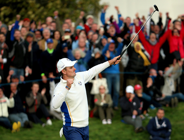 Justin Rose celebrates after holing a putt on the 18th green to secure a half-point for Europe in the afternoon foursomes ©Getty Images