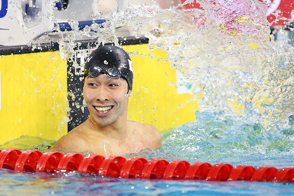 Kosuke Hagimo looks as if he cannot quite believe it after touching the wall first ©Getty Images