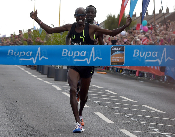 Mo Farah wins the men's title at the 2014 Great North Run ©Getty Images