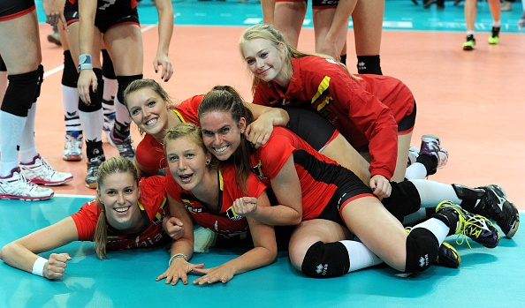 The Belgium team celebrate after beating Puerto Rico and securing their passage into the second round ©Getty Images