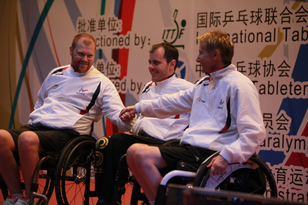 The French trio of Fabien Lamirault, Stéphane Molliens and Jean-François Ducay secured gold in the men's team class two contest ©ITTF
