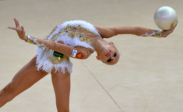 Yana Kudryavtseva's elegant ball routine has seen her take the lead in the standings ©AFP/Getty Images