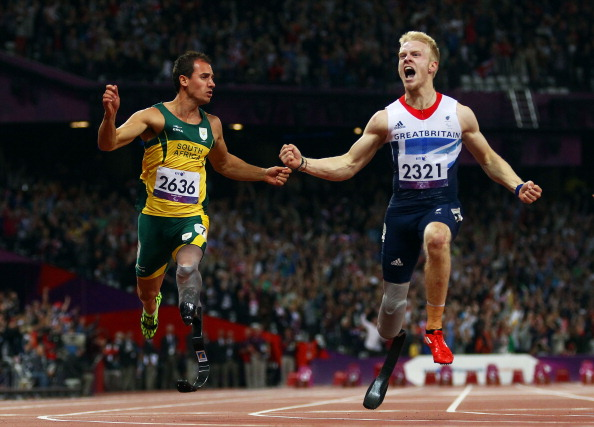 One of Sir Philip Craven's all-time favourite Paralympic moments - Britain's Jonnie Peacock wins the T44 100m at the London 2012 Paralympics ©Getty Images