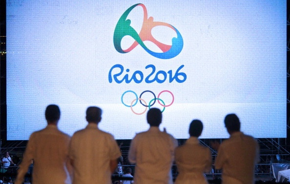 The Rio 2016 logo is launched, with IOC and Rio 2016 officials looking on ©Getty Images