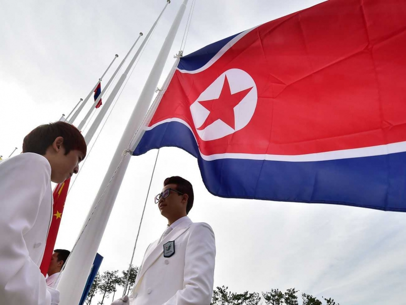 The North Korean Flag is raised in the Athletes' Village at Incheon 2014 ©AFP/Getty Images