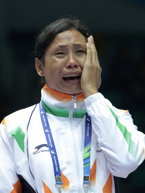 A devastated Sarita Devi refused to accept her bronze medal at the Asian Games in Incheon ©Getty Images