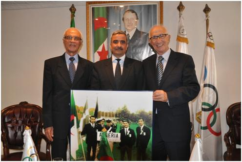 Algerian Olympic officials join to celebrate a half century of participation at the Games ©COA