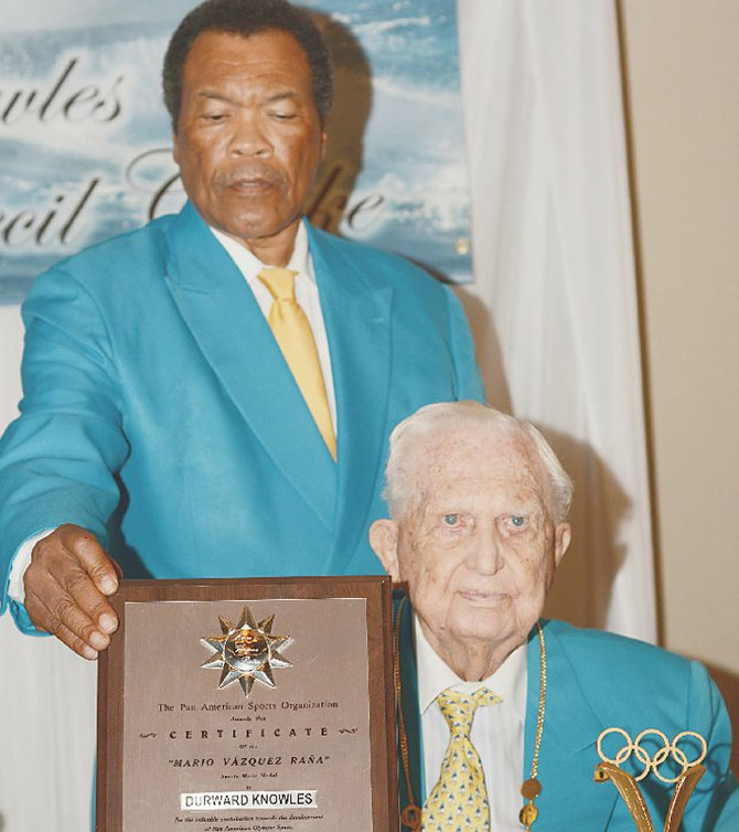 President of the Bahamas Olympic Committee Wellington Miller presents Sir Durward Knowles with the Pan American Sports Organization Medal and the Sports Merit Award ©BahamasOlympicCommittee