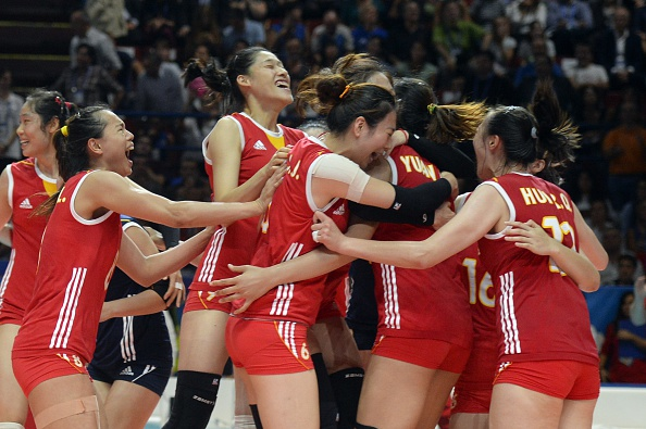China celebrate following their victory over Italy ©AFP/Getty Images