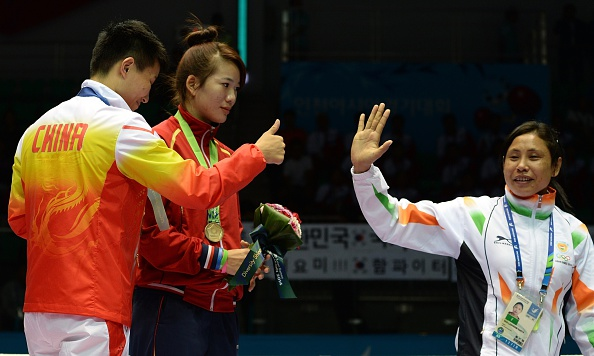 Indian boxer Sarita Devi has apologised for her behaviour during the medal ceremony, when she refused to accept her bronze medal in protest at the judging ©AFP/Getty Images