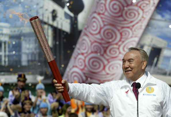 Nursultan Nazarbayev, President of Kazakhstan, holds the Olympic Torch in Almaty ahead of the 2008 Olympic and Paralympic Games in Beijing, fellow bidders for the 2022 Winter Games ©Getty Images