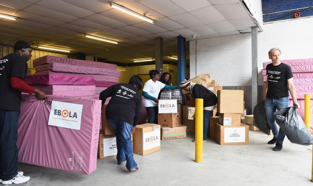 Members of London's Sierra Leone community come together to help load medical supplies into the container that will be shipped to the West African country ©WOA