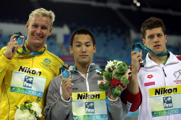 Naoya Tomita (centre) won a gold medal in the 200m breaststroke competition at the 2010 World Short Course Championships in Dubai ©Getty Images