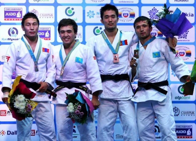 Yeldos Smetov (second from left) delivered gold for hosts Kazakhstan on the first day in Astana at the IJF Grand Prix ©IJF
