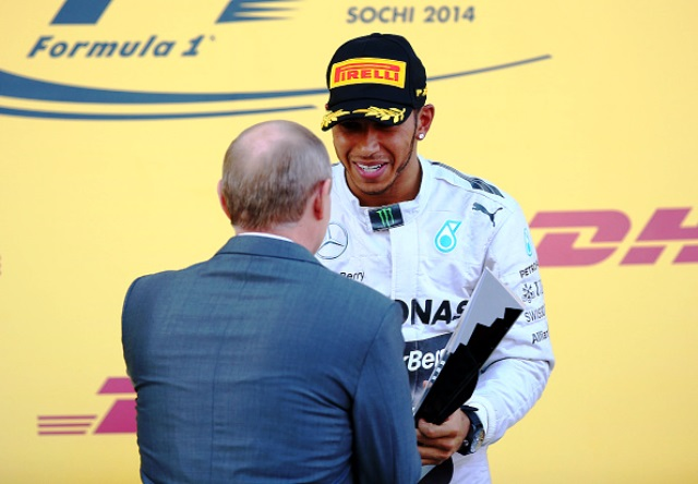 Lewis Hamilton is congratulated by Vladimir Putin after winning the inaugural Russian Grand Prix in Sochi ©Getty Images