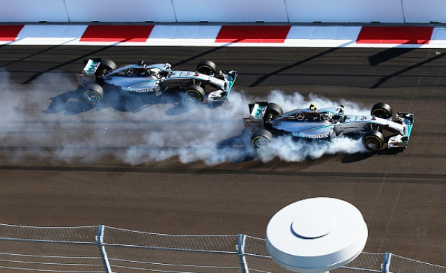Nico Rosberg locks his front wheels during his ultimately fruitless attempt to overtake Mercedes team mate Lewis Hamilton during lap one of the Russian Grand Prix ©Getty Images