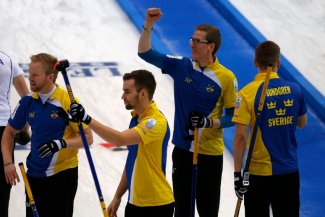 Sweden celebrate after reaching the final at the European Curling Championships ©WCF/Richard Gray