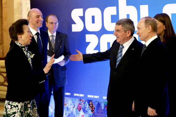 Dmitry Chernyshenko (left), pictured during Sochi 2014 with Vladimir Putin, IOC President Thomas Bach (centre) and British IOC member Prince Anne ©Getty Images