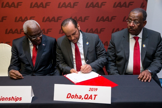 President of the IAAF, Lamine Diack, watches Sheikh Saoud Bin Abdulrahman Al-Thani, secretary general of the Qatar Olympic Committee, sign the contract to host the 2019 World Athletics Championships ©Doha 2019