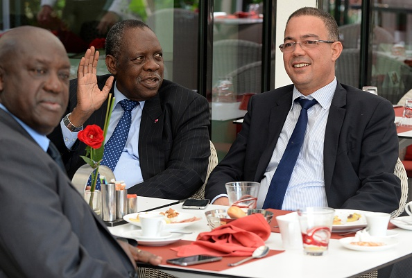 Issa Hayatou, CAF President, speaks to Fouzi Lekjaa (right), President of the Moroccan Football Federation, in early November to discuss the Morocco's request to postpone hosting the 2015 Africa Cup of Nations due to the Ebola epidemic ©Getty Images
