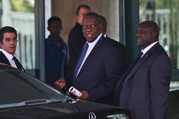 Issa Hayatou (centre), President of CAF, confirmed that Equatorial Guinea had agreed to host the 2015 Africa Cup of Nations ©Getty Images