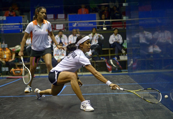 Malaysia's Nicol David (near), the world number one, will be aiming to guide her country to success ©Getty Images
