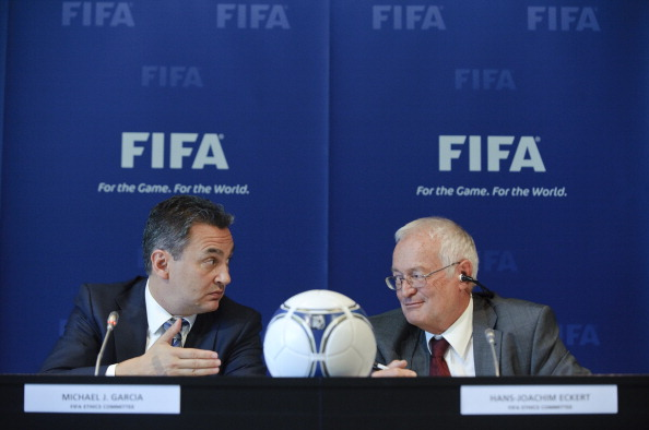 Michael Garcia (left) and Hans-Joachim Eckert (right) met yesterday to discuss the latter's 42-page report, which cleared Russia and Qatar to host the 2018 and 2022 World Cups ©Getty Images