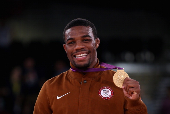 Nike will provide the medal stand uniforms that will be worn on the award podiums and during medal ceremonies at all Games until the end of 2020. Pictured is Jordan Burroughs picking up his wrestling gold at London 2012 ©Getty Images