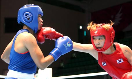 The boxing career of Sarita Devi (left) is over, according to AIBA President C K Wu ©Getty Images