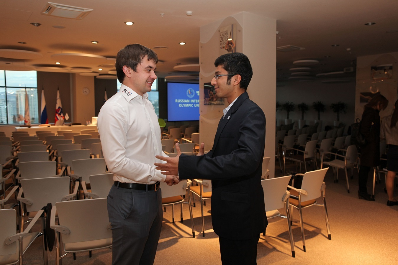 Sergei Vorobyev (left), deputy general director of Russian Grand Prix promoters Omega Centre, speaks with Parth Kalke (right), a RIOU MSA student ©RIOU