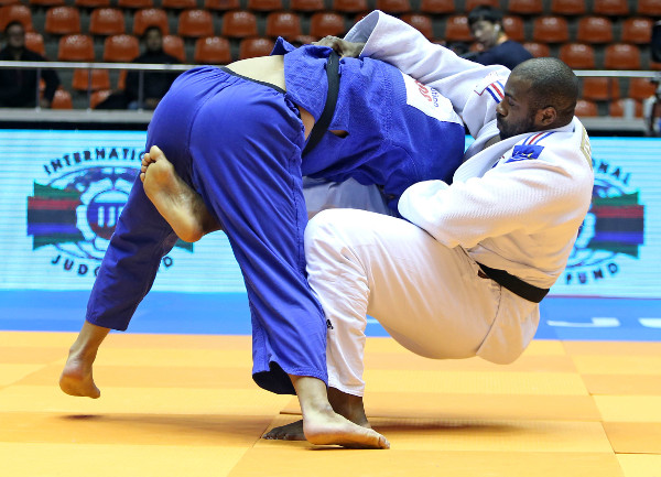 Teddy Riner (right) extended his remarkable unbeaten streak by easing to heavyweight gold in Jeju ©IJF