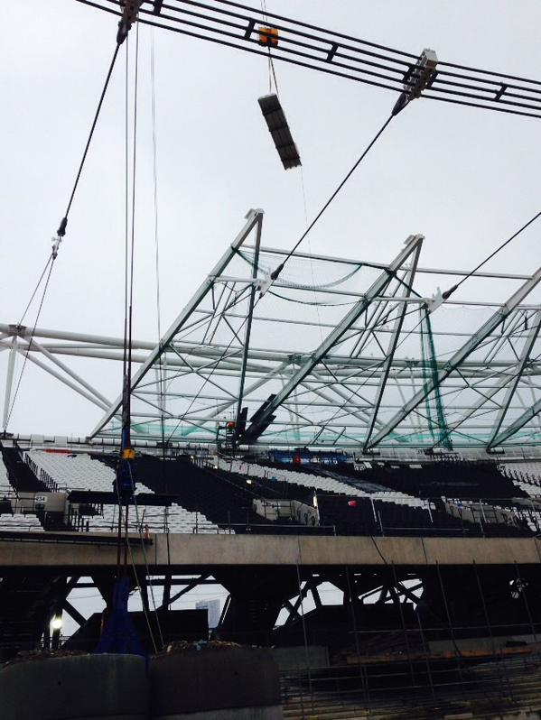 The first roof panel is lifted into place at the London Olympic Stadium ©Twitter