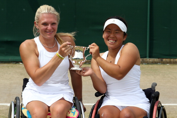 Yui Kamiji (right) and doubles partner Jordanne Whiley (left) face each other on the opening day of the NEC Wheelchair Tennis Masters ©Getty Images