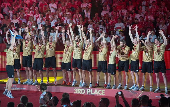 Germany, pictured celebrating their 2014 FIVB World Championship bronze medal, have withdrawn from the FIVB World League in order to focus on Baku 2015 ©AFP/Getty Images
