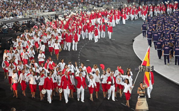 Isabel Fernández leads her country's delegation during the Athens 2004 Opening Ceremony ©Getty Images