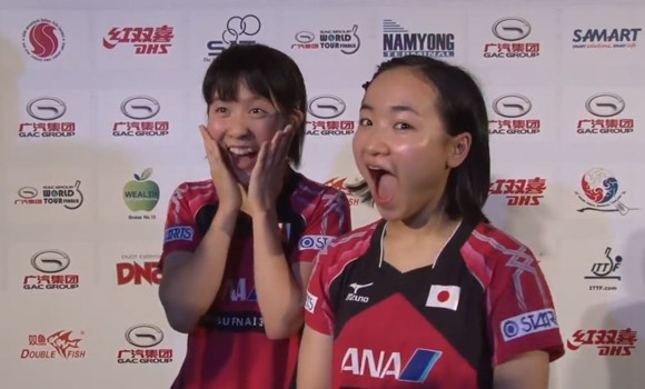 Japanese duo Miu Hirano (left) and Mima Ito (right) react to being told that they have won $40000 (£25,500/€32,100) ©ITTF
